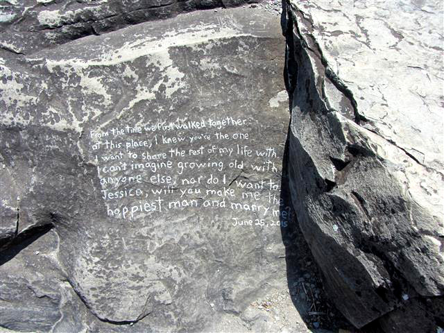 Marriage proposal written on the rocks at Hog's Back Falls.