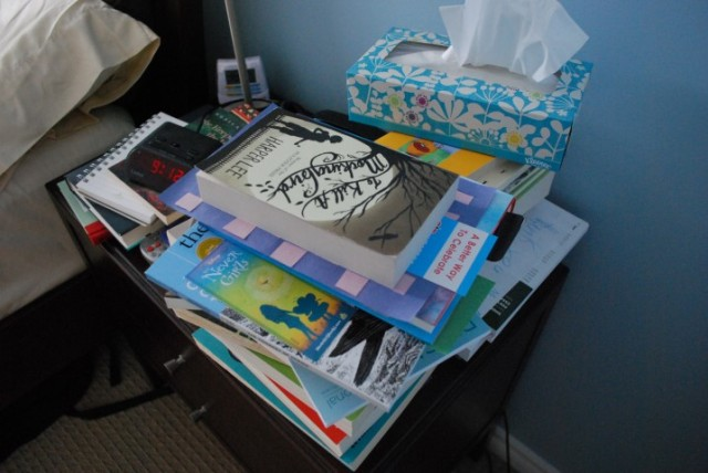 The horror that is my bedside table backlog. Not shown: overflow pile on the floor.
